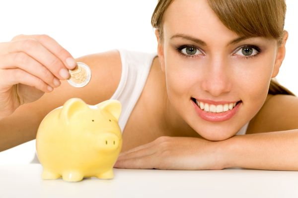 b_600_400_16777215_00_images_bigstock-woman-putting-coin-in-piggy-ba-4037794